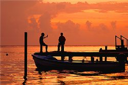 Sunset chatting on the beatiful island of Roatan, Honduras. by Shawn Jackson