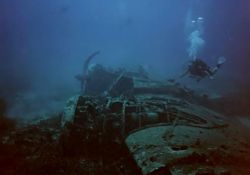 Diver over the wreck of a Blenheim Bomber in 42mtr. Taken... by Ian Palmer