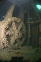 Wheel on the wreck of the James Egane Layne. Cornwall. D... by Derek Haslam