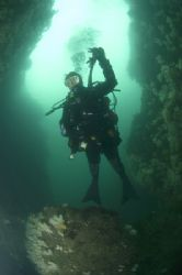 Diver in Gully at Wuddy Rock, St. Abbs, Scotland. 10.5mm ... by Mike Clark