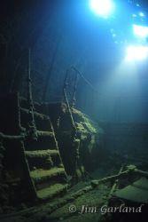 Engine room of the 'SHINKOKU MARU' Chuuk. Ambient light. by Jim Garland