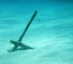 Simplicity, lone anchor under the water. by Lora Tucker