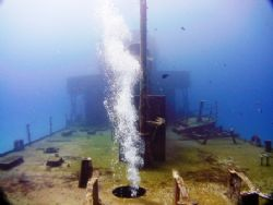 "Bubbles from diver penetrating the wreck ""Cañonero C53"" a... by Kenn Bolbjerg"
