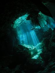 Dos Ojos Cenote. Snorkellers from downearth. Natural Light by Cipriano Gonzalez