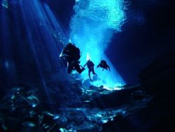 Divers exploring the cave system of Chac Mool. Fresh wate... by Kenn Bolbjerg