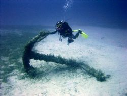 Diver on the anchor off Cirkewwa reef,Malta. by Ian Palmer