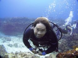 my dive buddy hopes to make a modelling career !!! by Kenn Bolbjerg