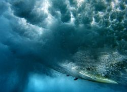 The Ride. This photo was taken under a breaking wave at S... by Mathew Cook