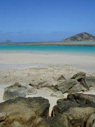 Secluded beach on a desert island. by Christine Huffard