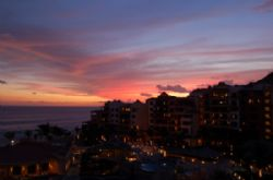 Sunset in Cabo San Lucas looking toward the Pedrogal. Enjoy. by Marylin Batt