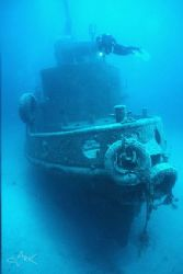 Rozi wreck and diver nik v with 15mm lens by Mike Clark