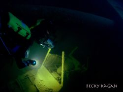 Chuuk lagoon inside th Heian Maru shooting projectiles st... by Becky Kagan