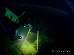 Chuuk lagoon inside th Heian Maru shooting projectiles st... by Becky Kagan