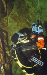 Just reeling, Diver retrieving line at the end of a cave ... by Teppo Lallukka