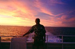 After a long days diving, enjoying a sunset treat aboard ... by Marylin Batt
