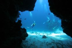 beautifull light in a cave cozumel by Eric Poulin