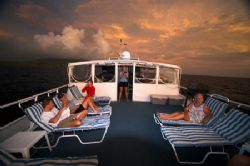 The top deck of the Caribbean Explorer 2 of the coast of ... by Terry Moore