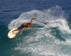 """Tweaked"" This surfer really put his all into this cutbac... by Mathew Cook"