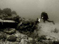 My buddy swims around an upsidown zero from WWII in 30ft ... by Becky Kagan
