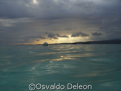 RELAXING SUNSET AT CARACOLES  CAY LAJAS PR by Osvaldo Deleon