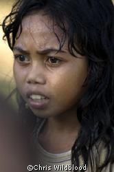 Girl in fishing village near Wakatobi. by Chris Wildblood