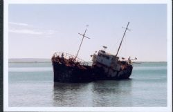 Old ship broken down ship in the bay in Black river Jamaica by Rebecca April
