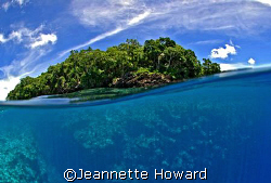 Small rock island in the Solomon Islands by Jeannette Howard