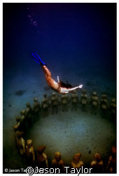 Donna diving into a new sculpture installation in Grenada. by Jason Taylor