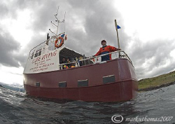Dive boat. Little Cumbrae, Clyde, Scotland. 10.5mm. by Mark Thomas