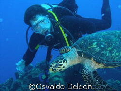 My friend Jaime and the turtle at Statia.  Saludos Jaime by Osvaldo Deleon