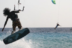 A Bonaire local displays his capabilities on his Kite Sur... by Terry Moore