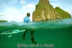 Young surfer at Cacimba do Padre's beach. Fernando de Nor... by Alexandro Auler