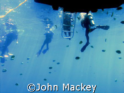 End of dive.....back to boat after diving USS Mahi in Hawaii by John Mackey