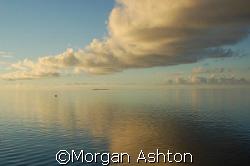 Dawn breaks near Mabul island.  by Morgan Ashton