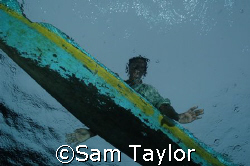 Ascending amidst the canoes, always the canoes.... Kimbe ... by Sam Taylor