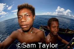 Local kids visit the dive deck. Kavieng PNG by Sam Taylor