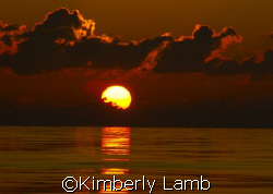 Gorgeous sunset off Little Cayman! by Kimberly Lamb