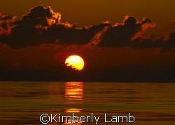 Gorgeous sunset off Little Cayman! by Kimberly Lamb