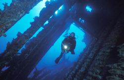 Entering the wreck of the Carnatic. 20mm lens by Len Deeley