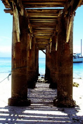 Abandoned dock in Babusanta beach, Samal City. Canon Ixus60 by Carlos Munda