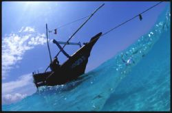 This dhow was anchored just in the surf off a sandbank, Z... by Andrew Woodburn