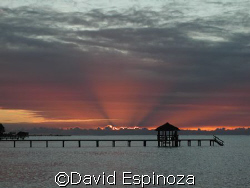 Sunset view from Sandy Bay, Roatan by David Espinoza