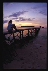 The pier on kadidiri Indonesia points to two islands over... by Andrew Woodburn