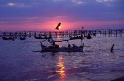 Fishermen setting out for the evening, Jimbaran Bay, Bali... by Douglas Van Blarcom