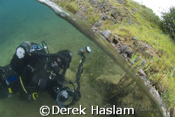 Mark in the shallows. Capernwray. D200, 10.5mm. by Derek Haslam