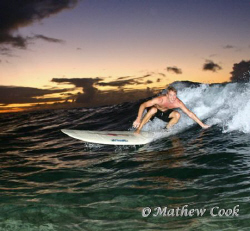 """""""Twilight Surfer""""  While the waves were'nt deathly large,... by Mathew Cook"""