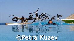 Getting swamped by the birds.... In the infinity swimmin... by Petra Kuzev