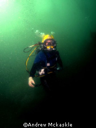 Surface supplied diver working on the bottom. by Andrew Mckaskle