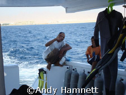 The good guys on the boat.  The little guy is Momo, 10 ye... by Andy Hamnett