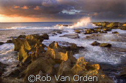 Sunset on the North Shore Oahu Hawaii.  by Rob Van Orden